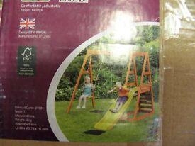 Plum Tarmarin Wooden playcentre swings and slide