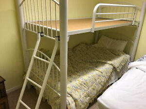 bunk bed with mattresses and ladder