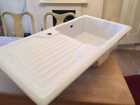 White ceramic country kitchen sink with drainer and tap hole