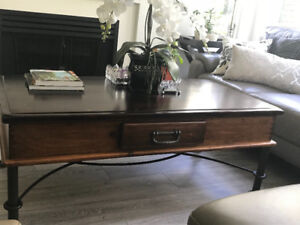 Solid wood coffee table with wrought iron