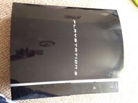 PlayStation 3 with controller and cables
