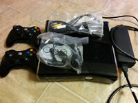 Xbox 360 250GB, 2 controllers and lots of games.