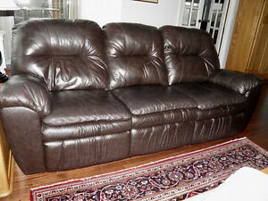 Fabulous leather sofa with a recliner at each end.