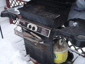 BBQ and Partially Full Propane Tank