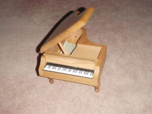 wooden baby grand piano made by Reuge