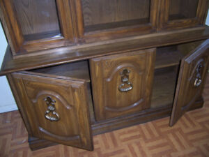 Large vintage 2 piece China cabinet with storage at bottom.