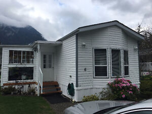 3 bdrm mobile home with covered deck and storage shed