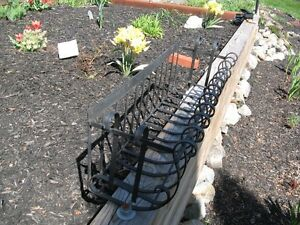 Wrought iron planters for flowers,etc.