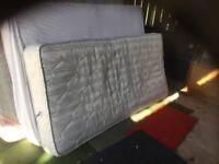 A single bed mattress.