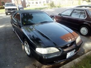 97 mustang gt 5 speed convertible 7000 obo.