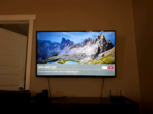 50 inch 4K UHD Tv/ Ps4 Pro 2 controllers and games