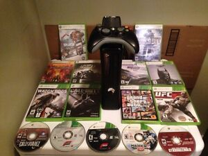 Selling Xbox 360 slim comes with games, controller, headset