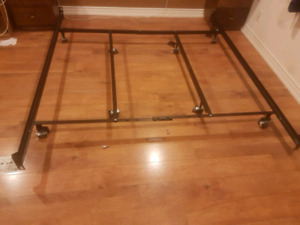 Metal king bed frame and two twin box springs