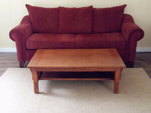 Couch, coffee table and rug