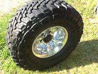 """33"""" 12.50 15 Toyo Open Country with Eagle Alloys"""
