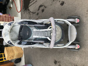 Well loved Graco double stroller.
