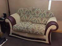 Floral Fabric sofa with leather trim
