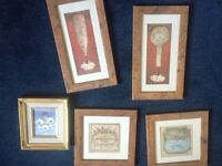 Various pictures and picture frames.