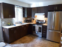 Large 2 BR apt w/new kitchen 2 parking spaces October 1st