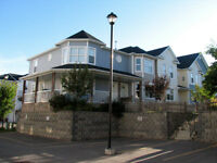 HIGH RIVER END UNIT CONDO WITH GARAGE AVAIL MAY 15