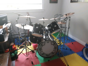 Large drum set and lots of cymbals