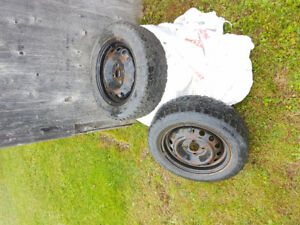 4 studded winter tires on rims (Price negotiable)