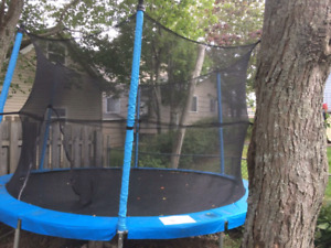 12 foot trampoline with safety net enclosure. ON HOLD PPU TOMORR