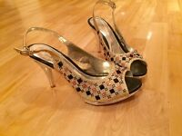 Peep toe gold and pink heels great for occasions or wedding