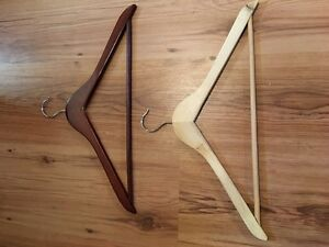 Wooden hangers- approximately 140 of them