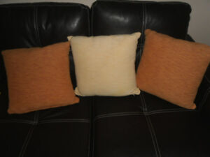 A SET OF 3 CUSHIONS
