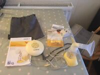 Medala Swing Electric breastfeeding pump with free new valves/membranes