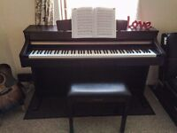 Yamaha Clavinova CLP 330. Perfect condition, looks brand new