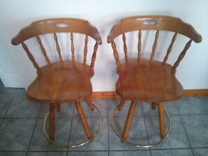 Two Swivel Chairs.
