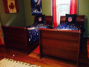 2 twin sleigh beds with matresses and box springs