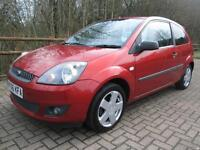 06/06 FORD FIESTA 1.4 ZETEC CLIMATE 3DR HATCH IN MET RED WITH SERVICE HISTORY