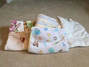 4 comfy baby blankets and a toddler pillow