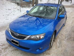 2008 blue Subaru Impreza