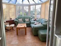 2 LEATHER SEATER SOFAS & LARGE FOOTSTOOL