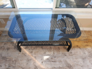 Plastic wicker table with glass top