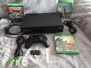 X Box One X parfaite condition + jeux - 485$