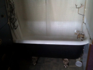 Antique Iron Claw foot tub (includes shower and curtain hardware