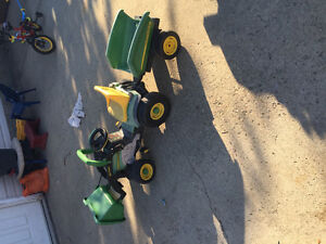 Boys tractor and power wheels and bikes