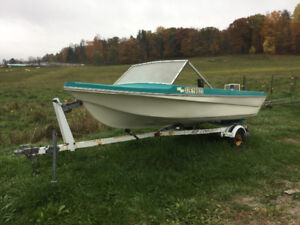 Boat and motor with trailer