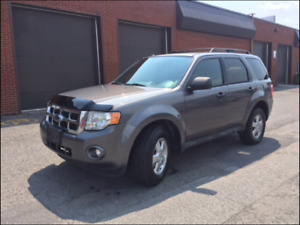 2009 Ford Escape xlt .Auto. 4cyl. FWD . 143 000km