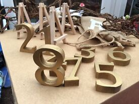 Wedding accessories rustic glass jam jars, gold table numbers & bunting