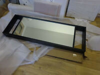 Wall mounted mirror in black wood frame