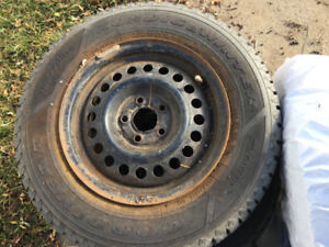 """Lightly Used Goodyear Nordic Winter Tire & Rims 14""""."""