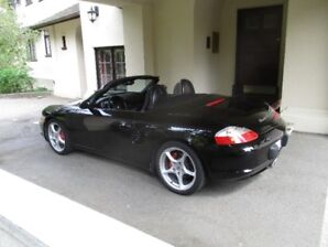 2003 Porsche Boxster S with manual transmission, triple black.