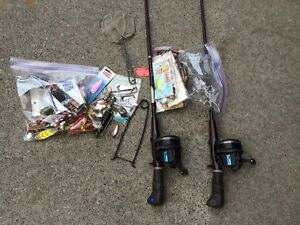 Lot of fishing tackle and 2 rod/reel combos