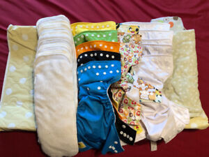 13 Cloth diapers + 1 change pad